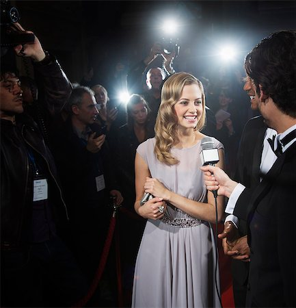 Celebrity being interviewed on red carpet Stock Photo - Premium Royalty-Free, Code: 6113-07159918