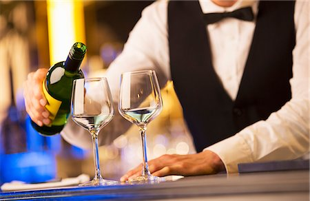 Well dressed bartender pouring wine Stock Photo - Premium Royalty-Free, Code: 6113-07159922