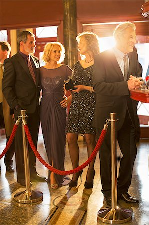 queue club - Well dressed couples waiting in bar line in theater lobby Stock Photo - Premium Royalty-Free, Code: 6113-07159937