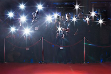 southeast asian ethnicity - Paparazzi using flash photography behind rope on red carpet Stock Photo - Premium Royalty-Free, Code: 6113-07160041