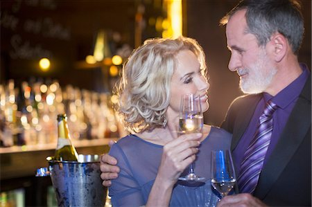 Close up of well dressed couple drinking champagne Stock Photo - Premium Royalty-Free, Code: 6113-07160051