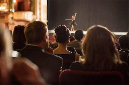 Rear view of theater audience watching performers on stage Stock Photo - Premium Royalty-Free, Code: 6113-07160083