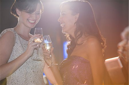 Well dressed women toasting champagne flutes Stock Photo - Premium Royalty-Free, Code: 6113-07160084