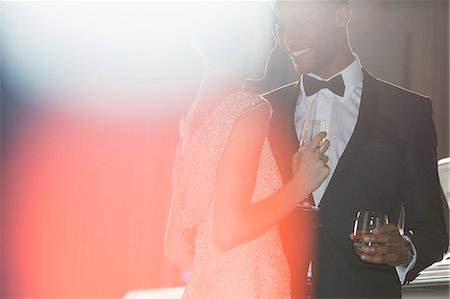 Well dressed couple drinking champagne and cocktail Stock Photo - Premium Royalty-Free, Code: 6113-07160088