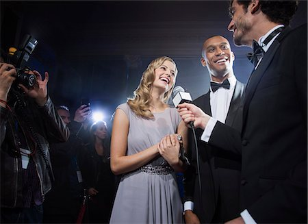 Well dressed celebrity couple being interviewed at red carpet event Stock Photo - Premium Royalty-Free, Code: 6113-07160096
