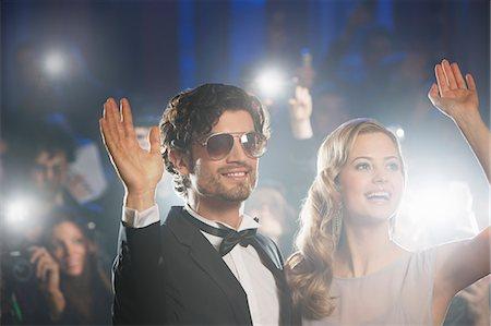 Well dressed celebrity couple waving to paparazzi Stock Photo - Premium Royalty-Free, Code: 6113-07160002