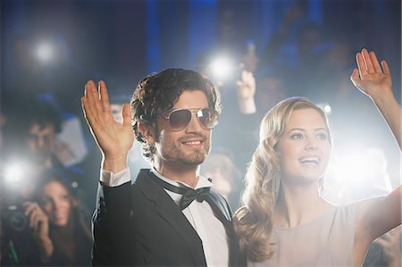 Well dressed celebrity couple waving to paparazzi Stock Photo - Premium Royalty-Free, Code: 6113-07160002