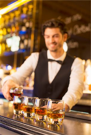 pouring - Well dressed bartender pouring bourbon in luxury bar Stock Photo - Premium Royalty-Free, Code: 6113-07160009