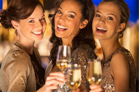 Close up portrait of smiling women toasting champagne flutes Stock Photo - Premium Royalty-Free, Code: 6113-07160022