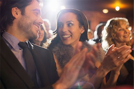Close up of couple clapping in theater Stock Photo - Premium Royalty-Free, Code: 6113-07160100