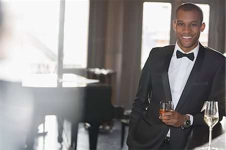 Portrait of well dressed man drinking cocktail in lounge Stock Photo - Premium Royalty-Free, Code: 6113-07160121