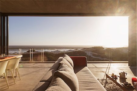 Modern living room overlooking ocean Stock Photo - Premium Royalty-Free, Code: 6113-07160136
