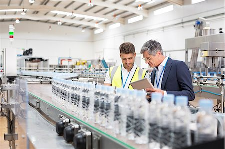 production - Supervisor and manager watching plastic bottles on conveyor belt Stock Photo - Premium Royalty-Free, Code: 6113-07160247