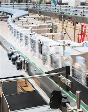 Bottles on conveyor belt in factory Stock Photo - Premium Royalty-Free, Code: 6113-07160255