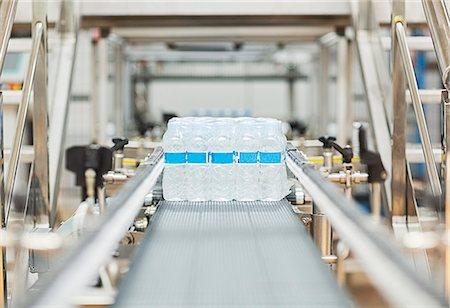 Water bottles on conveyor belt in factory Stock Photo - Premium Royalty-Free, Code: 6113-07160260