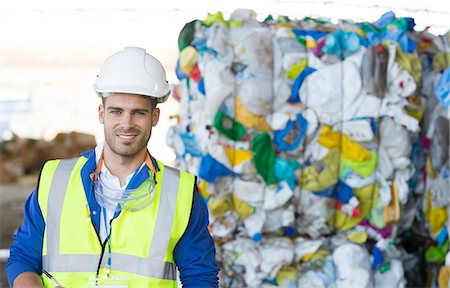 Worker smiling in recycling center Stock Photo - Premium Royalty-Free, Code: 6113-07160347