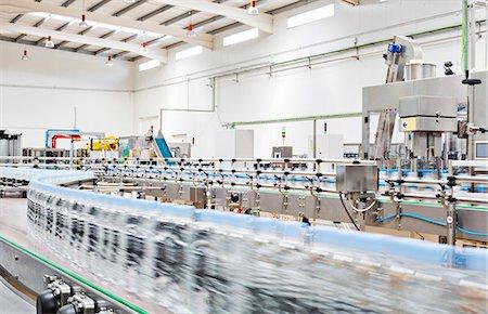 Bottles on conveyor belt in factory Stock Photo - Premium Royalty-Free, Code: 6113-07160300