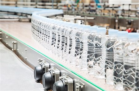Bottles on conveyor belt in factory Stock Photo - Premium Royalty-Free, Code: 6113-07160313