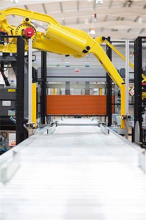 Robotic machinery in factory Stock Photo - Premium Royalty-Free, Code: 6113-07160326