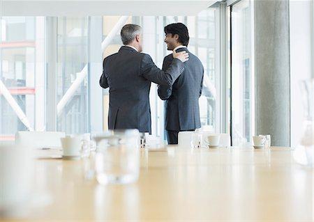 Businessmen talking in meeting Stock Photo - Premium Royalty-Free, Code: 6113-07160474
