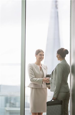 Businesswomen shaking hands in office Stock Photo - Premium Royalty-Free, Code: 6113-07160434