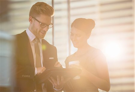 partnership - Business people using digital tablet in office Stock Photo - Premium Royalty-Free, Code: 6113-07160548