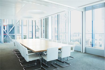 Empty meeting table in office Stock Photo - Premium Royalty-Free, Code: 6113-07160553