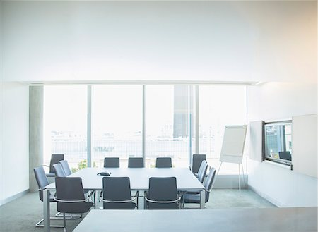 Empty meeting table in office Stock Photo - Premium Royalty-Free, Code: 6113-07160552
