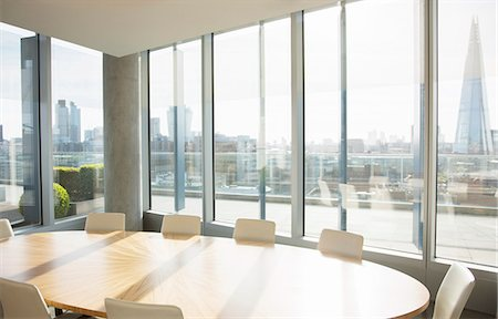 Empty conference room overlooking city Stock Photo - Premium Royalty-Free, Code: 6113-07160554