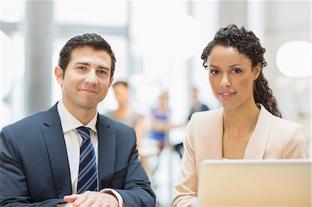 Business people smiling in office Stock Photo - Premium Royalty-Free, Code: 6113-07160522