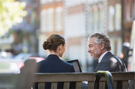 people sitting on bench - Business people talking on urban bench Stock Photo - Premium Royalty-Free, Code: 6113-07160648