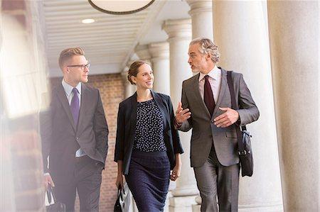 pillar - Business people talking in outdoor corridor Stock Photo - Premium Royalty-Free, Code: 6113-07160685