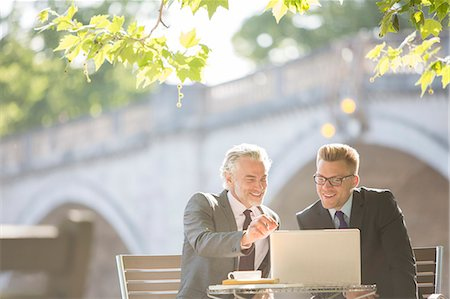people sitting on bench - Businessmen working at sidewalk cafe Stock Photo - Premium Royalty-Free, Code: 6113-07160697