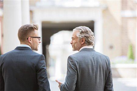 partnership - Businessmen talking on city street Stock Photo - Premium Royalty-Free, Code: 6113-07160694