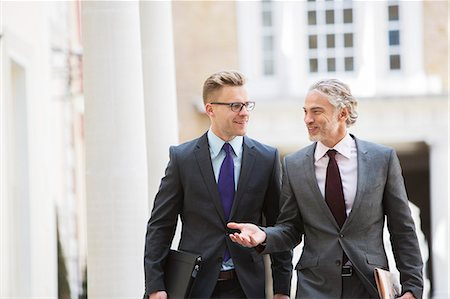 Businessmen talking outdoors Stock Photo - Premium Royalty-Free, Code: 6113-07160696