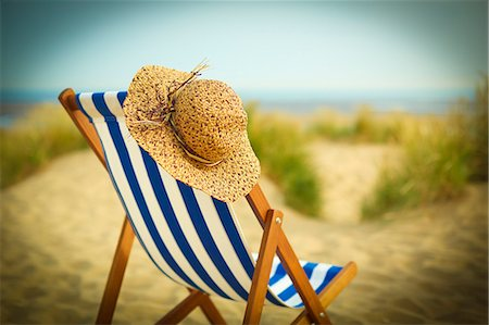 still life - Sun hat on chair on beach Stock Photo - Premium Royalty-Free, Code: 6113-07160763