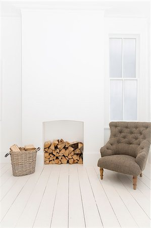 Firewood and armchair in living room Stock Photo - Premium Royalty-Free, Code: 6113-07160733