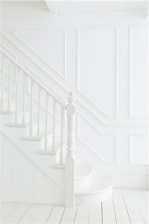 Banister and staircase in white foyer Stock Photo - Premium Royalty-Free, Code: 6113-07160737