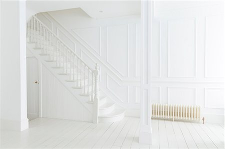 White staircase and walls in ornate house Stock Photo - Premium Royalty-Free, Code: 6113-07160739