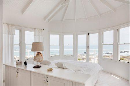 White bedroom overlooking ocean Stock Photo - Premium Royalty-Free, Code: 6113-07160847