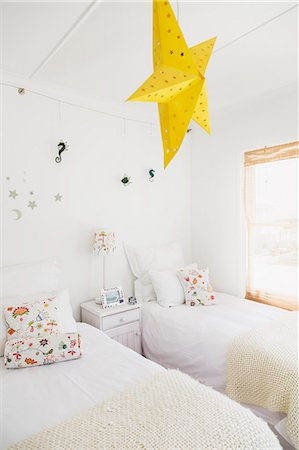 decoration - Yellow star lamp and wall decorations in childrens bedroom Stock Photo - Premium Royalty-Free, Code: 6113-07160853