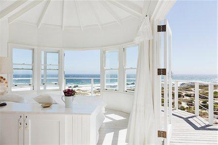 White bedroom overlooking ocean Stock Photo - Premium Royalty-Free, Code: 6113-07160865
