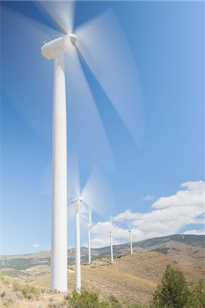 Wind turbines spinning in rural landscape Photographie de stock - Premium Libres de Droits, Code: 6113-07160879