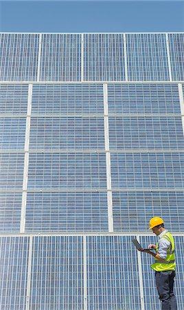 solar power - Worker examining solar panels Stock Photo - Premium Royalty-Free, Code: 6113-07160882