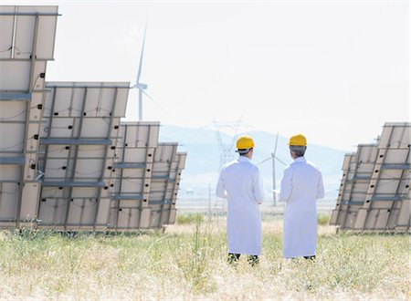 solar power - Scientists standing by solar panels in rural landscape Stock Photo - Premium Royalty-Free, Code: 6113-07160895