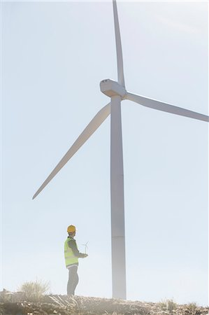 safety - Businessman examining wind turbine in rural landscape Stock Photo - Premium Royalty-Free, Code: 6113-07160961