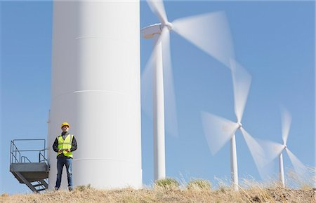 Worker by wind turbines in rural landscape Stock Photo - Premium Royalty-Free, Code: 6113-07160962