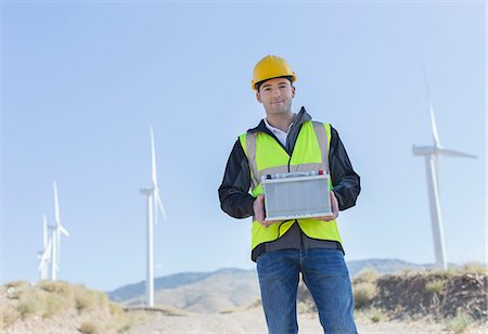 Worker standing by wind turbines in rural landscape Photographie de stock - Premium Libres de Droits, Code: 6113-07160964