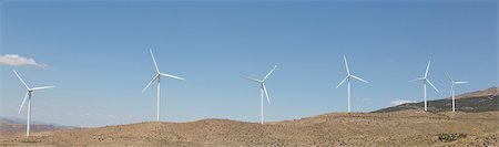 Wind turbines spinning in rural landscape Photographie de stock - Premium Libres de Droits, Code: 6113-07160971