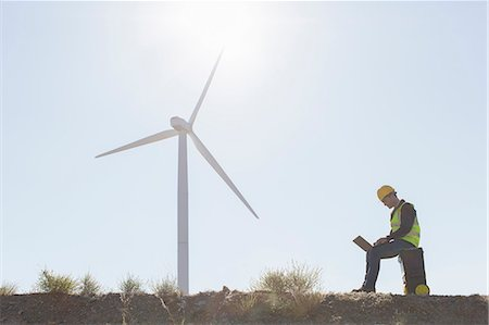 Worker using laptop by wind turbine in rural landscape Stockbilder - Premium RF Lizenzfrei, Bildnummer: 6113-07160903